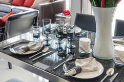 Black dinning table with table set Stock Photography