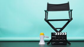 Free BLACK Director Chair With Megaphone And Clapperboard Or Movie Clapper Board On Green Or Tiffany Blue And Black Floor Background.it Royalty Free Stock Image - 216552996