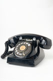 Black dirty broken old style telephone. No retouch photo of black dirty broken old style telephone on white background Stock Photos