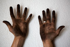 Black dirty man hands open palms on white Royalty Free Stock Photography