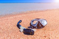 Black diving mask and snorkel. On the beach sand Stock Image