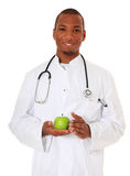 Black doctor holding green apple Royalty Free Stock Photo