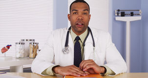 Black doctor talking to camera Royalty Free Stock Photography
