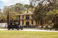 Black 1929 Dodge Brothers Model B drives in front of the 1929 Planetary Court at the 10th Annual Classic Car. Estero, Florida, USA - February 23, 2019: Black royalty free stock photography