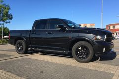Black Dodge Ram pick. Almere, The Netherlands - May 25, 2017: Black Dodge Ram pick up parked in a public parking lot in the city of Almere stock photo