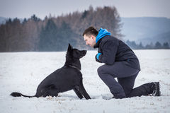 Black dog with his owner Royalty Free Stock Photos