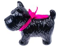 Black dog statuette isolated on white background. Studio Photo stock photo