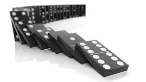 Black domino tiles falling in a row. Isolated on white Stock Images