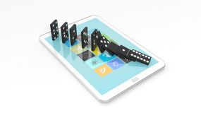 Black domino tiles falling in a row on tablet screen. On white Royalty Free Stock Image