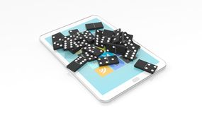 Black domino tiles randomly piled on tablet screen Stock Photo