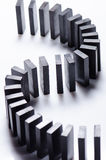 Black dominoes in a row Stock Images