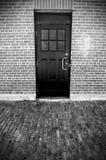Black Door in Brick Building Stock Images