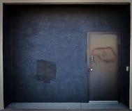 Black Door Entrance. Black wall and door entrance to a building stock photography