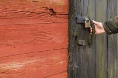 Black door handle. Black doorhandle at an old barn Stock Photography