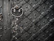 Black door with rivets Stock Image