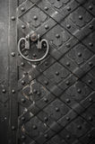 Black door with rivets Royalty Free Stock Photography
