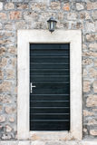 Black Door. On a  stone building Stock Photo