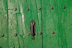 Black doorknob on green Stock Photo