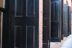 Black Doors. Open black doors in a row Stock Images