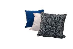 Black dot and pale pink and blue pattern cushion isolated. With white background stock photo