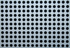 Black dots. A perforated metal cladding sheet used to cover building stuctures Royalty Free Stock Photos