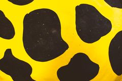 Black dots, orange background. Black dots with orange background like giraffe skin royalty free stock image