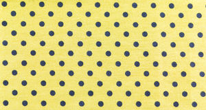 Black dots on Yellow Background Royalty Free Stock Photo