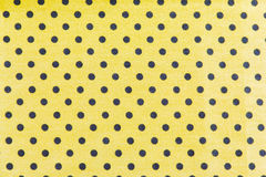 Black dots on Yellow Background. Yellow Fabric and black Tiny Polka Dots Background Stock Photo