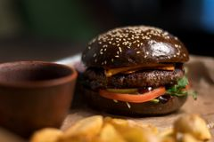 Black double hamburger made from beef, cheese and vegetables-2. Stock Photo