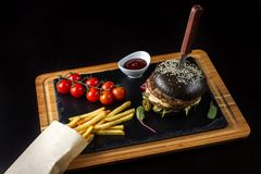 Black double hamburger made from beef with jalapeno pepper, cheese and vegetables-5 Stock Images