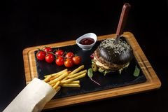 Black double hamburger made from beef with jalapeno pepper, cheese and vegetables-5 Royalty Free Stock Photos