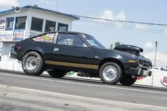 Black drag car on the track at the starting line ready to start Stock Photo