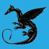 Black dragon on the blue Stock Images