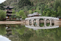 Black Dragon Park. Bridge and pagoda in Black Dragon park in Lijiang, China Royalty Free Stock Images