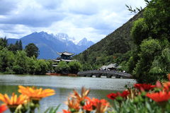 Black Dragon Pool Park-Lijiang old town scene. Lijiang old town scene-Black Dragon Pool Park. . In the there, you can see Jade Dragon Snow Mountain stock photos