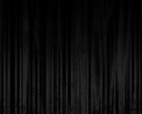 Black drapes. Movie or theater curtains with some folds in it Royalty Free Stock Image