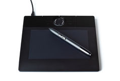 Black drawing tablet with pen Stock Photo