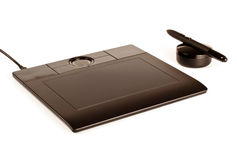Black drawing tablet with pen Stock Photos