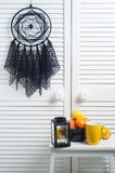 Black dream catcher with crocheted doilies Stock Photos