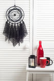Black dream catcher with crocheted doilies Stock Photo