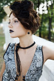 Black dress. The Portrait of a white girl in a vintage dress Royalty Free Stock Image