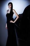 Black dress. Girl in black dress with flying train Royalty Free Stock Photography