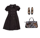 Black dress with accessories on white isolate with clipping path Stock Images