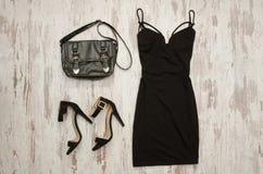 Black dress, bag and black shoes. Fashionable concept Stock Image