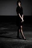 Black Dress Standing In Shadow. Photo Of A Beautiful Young Woman In A Black Dress Royalty Free Stock Photo