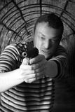 Black dressed man with gun stock photos