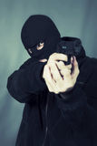 Black dressed man with gun Royalty Free Stock Images