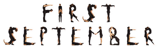 Black dressed people forming FIRST SEPTEMBER word Stock Images