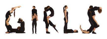 Black dressed people forming GIRLS word Royalty Free Stock Image