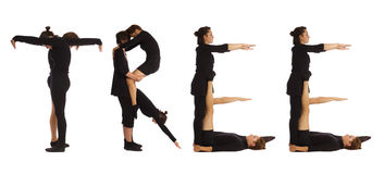 Black dressed people forming TREE word Stock Photography